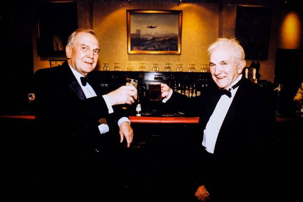 Jack Mason and his pilot, George Sidebotham, enjoy a drink at the RAF club in London in 1997.
