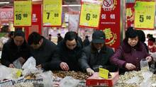 Customers shop at a supermarket ahead of the Spring Festival in Huaibei, Anhui province, February 8, 2013. China's exports and imports surged in January as the first hard data of the year pointed to robust domestic demand and a pick up in the economy not solely explained by the timing of the Lunar New Year holiday. (Reuters)