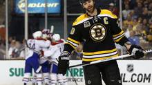 May 14, 2014; Boston, MA, USA; Boston Bruins defenseman Zdeno Chara (33) skates away as the Montreal Canadiens celebrate after Chara deflected a shot into his own goal during the third period of Montreal's 3-1 win in game seven of the second round of the 2014 Stanley Cup Playoffs at TD Garden. Mandatory Credit: Winslow Townson-USA TODAY Sports (Winslow Townson/USA Today Sports)