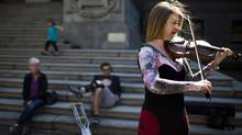 Christina Wolf plays her violin outside the Vancouver Art Gallery on May 16, 2012. (Rafal Gerszak for The Globe and Mail)