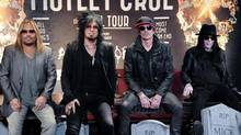 From left, Vince Neil, Nikki Sixx, Tommy Lee, and Mick Mars attend the Motley Crue Press Conference, Tuesday, Jan. 28, 2014, in Los Angeles. (Richard Shotwell/Invision/AP)