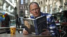 William Gibson, seen here in the indoor public area at the Vancouver Public Library in Vancouver, B.C., also enjoys the writings of ... William Gibson. (Jeff Vinnick/The Globe and Mail)