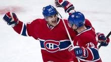 Montreal Canadiens' Max Pacioretty, left, congratulates teammate Andrei Markov on his goal against the Florida Panthers on Jan. 22, 2013, in Montreal. (Paul Chiasson/The Canadian Press)