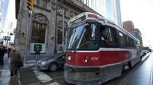 Transit drivers aren't just responsible for ferrying passengers safely; they are also 'the eyes of the community,' one driver said. (DEBORAH BAIC/THE GLOBE AND MAIL)