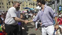 NDP leader Thomas Mulcair shakes hands with Liberal Party of Canada leader Justin Trudeau as they attend an outdoor church service before Toronto's Gay Pride Parade, June 30, 2013 (Mark Blinch/Reuters)