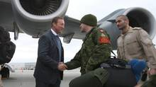 Minister of Defence Peter MacKay shakes hands with Canadian forces members of Squadron 429 at CFB Trenton, on Tuesday Jan. 15, 2013. Canada is sending the C-17 Globemaster to help France with the conflict in Mali. (Lars Hagberg/THE CANADIAN PRESS)