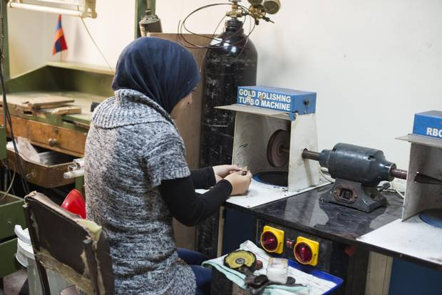 Refugees around the world are being trained to make pins for The Pin Project in workshops like this one in Amman, Jordan.
