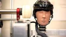 A test dummy performs an impact test at the Neurotrauma Impact Science Laboratory at the University of Ottawa. (Dave Chan/The Globe and Mail)