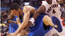 The decks have been cleared for Hedo Turkoglu, left, and Chris Bosh, right, to become teammates in Toronto. (MARK BLINCH/Reuters)