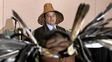 National Chief Shawn Atleo as seen through ceremonial eagle feathers, speaks at a news conference in Vancouver, BC, June 24, 2010. Leaders of both the Sto:lo and Chehalis First Nations held the news conference to address significant issues arising from a trail of First Nations citizens charged with illegally trafficing in Bald eagle parts. (Lyle Stafford/The Globe and Mail/Lyle Stafford/The Globe and Mail)