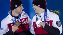 Canadian moguls gold medallist Alex Bilodeau and silver medallist Mikael Kingsbury share a laugh after receiving their medals during a ceremony at the Sochi Winter Olympics on Tuesday, February 11, 2014, in Sochi, Russia. (Adrian Wyld/THE CANADIAN PRESS)