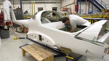 Workers at Diamond Aircraft in London, Ont., are seen in this file photo. Statscan says factory sales rose 1.7 per cent in November. (Mark Spowart For The Globe and Mail)