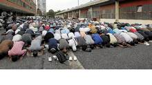 A group of Muslims pray in front of an old barrack in Paris on Sept.16, 2011, as part of Friday prayers. A ban on praying in French streets came into effect today. (PATRICK KOVARIK/AFP/Getty Images/PATRICK KOVARIK/AFP/Getty Images)