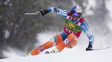 Asksel Lund Svindal, of Norway, races during the Men's Super G ski race in Lake Louise, Alta, Sunday, Dec. 1, 2013. (JONATHAN HAYWARD/THE CANADIAN PRESS)