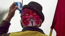 A protesters wears a Guy Fawkes mask during a demonstration against tuition hikes and Bill 78 in Montreal on June 2, 2012. (Christinne Muschi/Reuters)
