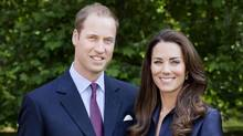 A handout image released by St James's Palace on June 23, 2011 shows Britain's Prince William, Duke of Cambridge and Catherine, Duchess of Cambridge posing for the official tour portrait for their trip to Canada and California in the Garden's of Clarence House in London, on June 3, 2011. (Chris Jackson / AFP / Getty Images/AFP PHOTO / St James's Palace / HO)