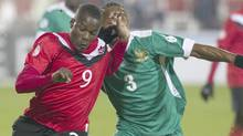 Canada's Toisant Ricketts (left) battles for the ball with St. Kitts and Nevis' Gerard Williams during second half World Cup qualifying soccer action in Toronto on Tuesday November 15, 2011. (Chris Young/THE CANADIAN PRESS)