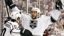 Los Angeles Kings' Dwight King (74) celebrates his goal against the Phoenix Coyotes with teammate Mike Richards (10) during the second period of Game 1 of the NHL hockey Stanley Cup Western Conference finals, Sunday, May 13, 2012, in Glendale, Ariz.(AP Photo/Ross D. Franklin) (Ross D. Franklin/AP)