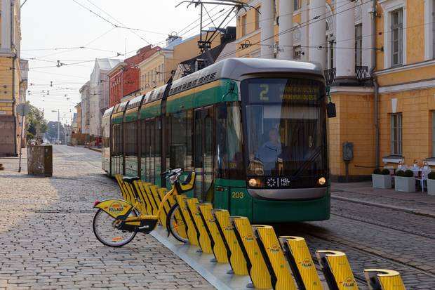 A tram in Helsinki's city centre. Helsinki's integrated transit plan aims to make private auto use unnecessary in the city centre by 2025.