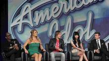 From left, judges Randy Jackson, Mariah Carey, Keith Urban, Nicki Minaj and host Ryan Seacrest attend a Fox panel for the television series American Idol at the 2013 Winter Press Tour for the Television Critics Association in Pasadena, Calif. (MARIO ANZUONI/REUTERS)