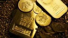 Gold bars (Ian Barrett/IAN BARRETT PO Box 421, Stn B, Montreal, Quebec, Canada H3B 3J7 (514)924-7475 ianb@pubnix.net)