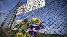 A small memorial of flowers is seen at Canandaigua Motorsports Park on Monday (Mel Evans/AP)