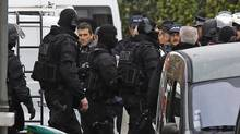 French special intervention police officers are seen near the building where the chief suspect in a killing spree was holed up in Toulouse, on March 22, 2012. (Remy de la Mauviniere/AP/Remy de la Mauviniere/AP)