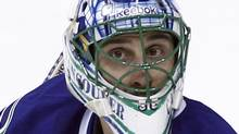 Vancouver Canucks' goaltender Roberto Luongo watches a shot from the Phoenix Coyotes during the third period of their NHL hockey game in Vancouver, British Columbia March 14, 2012. REUTERS/Ben Nelms (Ben Nelms/Reuters)