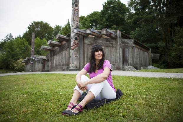 Nika Collison sits in front of the Haida Longhouse at the UBC Museum of Anthropology in Vancouver. As co-chair of the Haida Repatriation Committee, she brokered the deal that brought the mountain goat moon chest to the Haida Gwaii Museum.