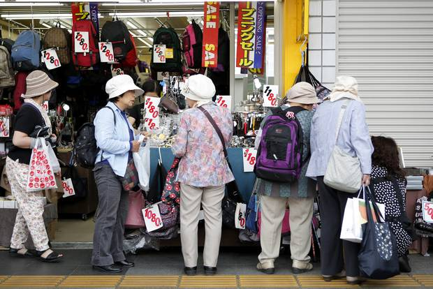 Shoppers browse at a store in the Sugamo district of Tokyo. (Kiyoshi Ota/Bloomberg)
