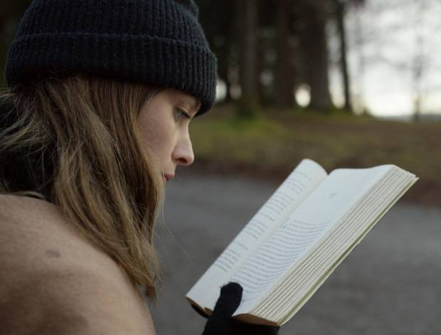 A scene in Mark Lewis's film, Canada, tracks a young woman reading the 2012 book Canada, by Richard Ford.