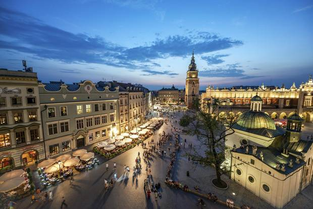 A view of the market square in Krakow at sunset.