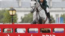 Saudi Arabia's Prince Abdullah Al Saud rides Davos during the equestrian individual jumping second qualifier in Greenwich Park at the London 2012 Olympic Games on Sunday. (MIKE HUTCHINGS)