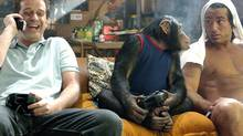 In a scene from Grandma's Boy, Alex (Allen Covert) and Monkey (Harry the Chimp) play video games while Dante (Peter Dante) watches.
