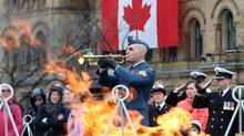 A member of the Canadian military plays the Last Post during the Battle of the Atlantic memorial ceremonies at the Eternal Flame on Parliament Hill in Ottawa on May 4. (FRED CHARTRAND/THE CANADIAN PRESS)