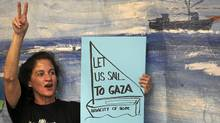 An activist takes part in a news conference in Athens announcing plans for a flotilla of ships to break the Israeli blockade of Gaza. (YIORGOS KARAHALIS/YIORGOS KARAHALIS/REUTERS)