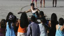 Canadian pop singer Justin Bieber greets his fans in a resort in Punta Chame, on the outskirts of Panama City January 27, 2014. (CARLOS JASSO/REUTERS)
