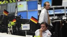 A traders looks at screens at the Frankfurt stock exchange June 18, 2012. (ALEX DOMANSKI/REUTERS)