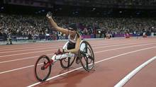Canada's Michelle Stilwell celebrates after winning the women's 200m T52 classification final at the Olympic Stadium at the London 2012 Paralympic Games September 1, 2012. (SUZANNE PLUNKETT/REUTERS)