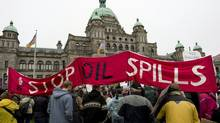 Protesters take part in a sit-in in front of the British Columbia legislature to protest the proposed Northern Gateway pipeline on Oct. 22, 2012. (JONATHAN HAYWARD/THE CANADIAN PRESS)