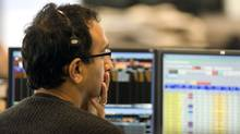 TSX trader watches the action (CHRIS YOUNG/Chris Young/CP)