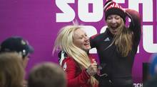 Canada's Kaillie Humphries and Heather Moyse react to winning gold February 19, 2014 in the women's bobsled competition at the Sochi Games. (John Lehmann/The Globe and Mail)