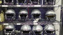 Western helmets are lined up on a shelf and connected to a power source, recharging the batteries of the GFTs. London, Ontario ---2013-11-12--- The helmets of the Western Mustangs football team recharge their impact sensor before practice November 12, 2013. GEOFF ROBINS The Globe and Mail (GEOFF ROBINS For The Globe and Mail)