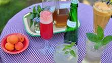Gayla Trail's fondness for growing herbs has resulted in a repertoire of unusual drinks recipes, including (clockwise from left) watermelon/mint prosecco, lavender and apricot smoothies, lemon basil spritzers and lemon basil gimlets. A key ingredient in the last two is homemade lemon basil simple syrup (middle). (Gayla Trail for The Globe and Mail)