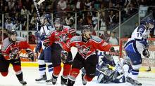 Gabriel Dumont of the Drummondville Voltigeurs celebrates his game-winning goal in overtime against the Rimouski Oceanic on Wednesday night at the Memorial Cup. (Richard Wolowicz/2009 Getty Images)