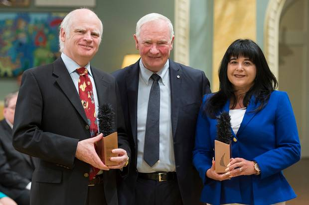 David Johnston giving the Governor-General's Innovation Award to Patricia Lingley-Pottie and Michael McGrath, who accepted the prize on behalf of his brother, Patrick McGrath.