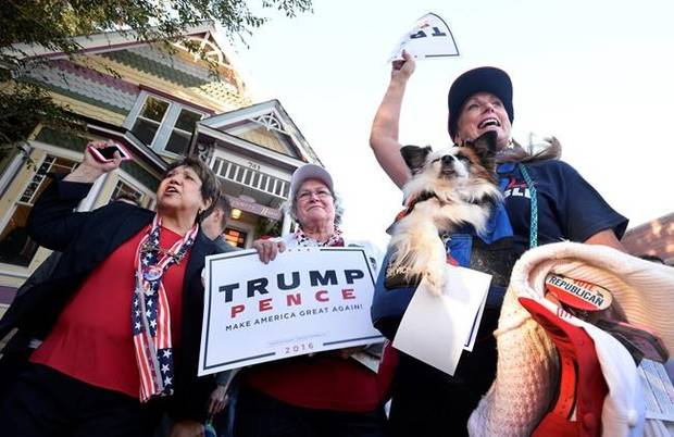 Donald Trump supporters Mary Claire, from left, Colette McDonald and Karolee McLaughlin, with her dog Lakota, spar with protesters in Boulder, Colorado, on Monday.