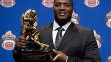 B.C. Lions offensive tackle Jovan Olafioye holds the trophy for Most Outstanding Offensive lineman trophy as he poses for photographers during the CFL awards show in Toronto Thursday, November 22, 2012. With Olafioye saying no to the NFL, the B.C. Lions have fewer worries about their injury-riddled offensive line with the return of the CFL's top lineman last season. (Sean Kilpatrick/THE CANADIAN PRESS)
