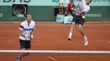Max Mirnyi of Belarus, right, and Daniel Nestor of Canada, left, play Juan Sebatian Cabal of Colombia and Eduardo Schwank of Argentina in the men's doubles final of the French Open tennis tournament in Roland Garros stadium in Paris, Saturday June 4, 2011. (Lionel Cironneau/AP)