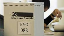 An Elections Canada official waits for voters to cast their ballots at a Montreal polling station on May 2, 2011. (Graham Hughes/THE CANADIAN PRESS)